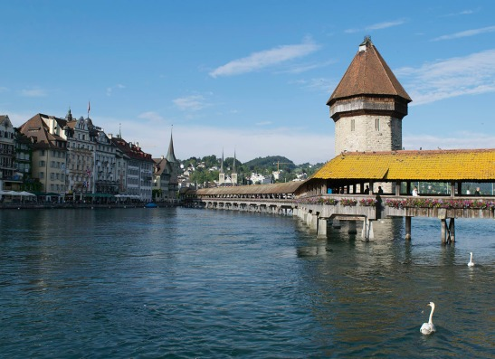 Lucerne: The Wasserturm and Kapellbrucke from the Bahnhofstrasse, looking to the Hofkirche.  Photograph by David Hill, 26 May 2014, 18.25  The Hofkirche only becomes visible near the Jesuitenkirche, and is not actually visible from the Reussbrucke. Click on image to enlarge