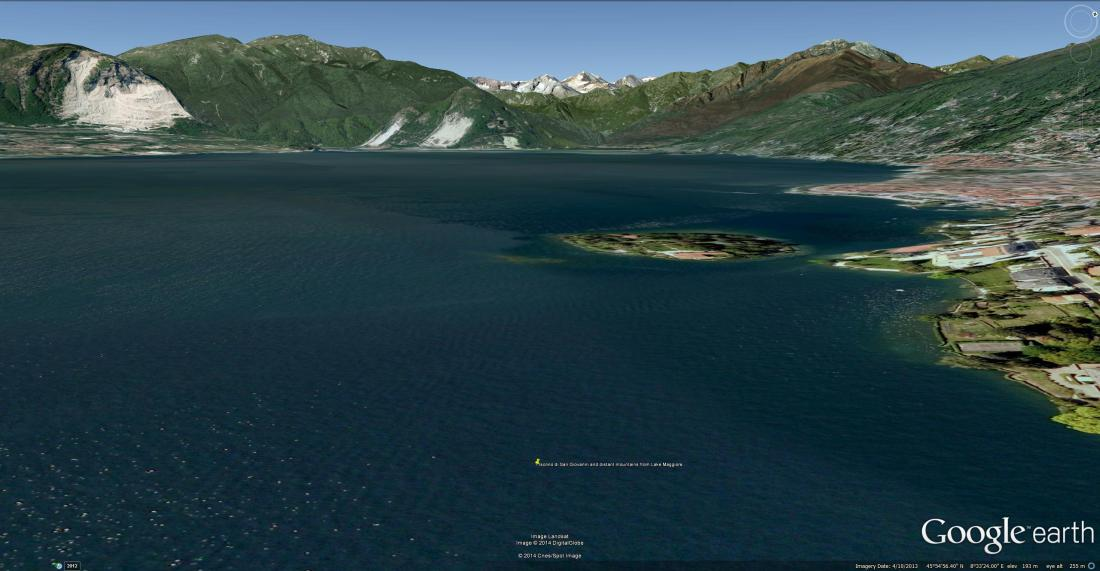 Google Earth aerial view of Isolina di San Giovanni, with Pallanza to the right, and the snow-capped Weissmies in the distance.  Ruskin recorded the view from a rowing boat.