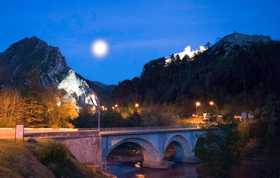 Sisteron by Moonlight: Looking over the Pont du Buech to the Citadel and the Rocher de la Baume Photograph by David Hill. Click to enlarge and then 'back' to return to this page.