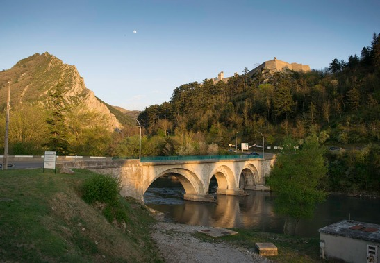 Moonrise, Sisteron. Looking over the Pont du Buech with the shadow of the citadel visible on the Rocher de la Baume. Photograph by David Hill, 12 April 2014, 19.47.06 Click on image to enlarge; use 'back' button to return