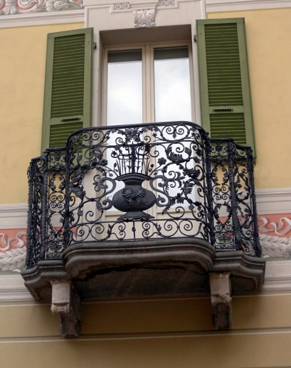 Balcony on a house in the Piazza Collegiata, Bellinzona This house is at the north end of the west side of the Piazza. Photograph by David Hill taken 1 November 2012, about 2.00 pm.