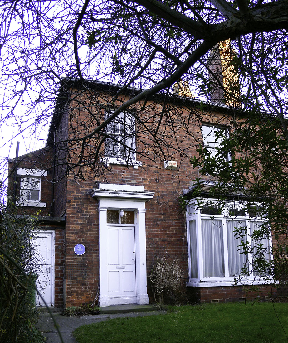 Grimshaw's House, The Villas, no.56 Cliff Road, Hyde Park, Leeds Photograph by David Hill, taken 3 February 2015, 16.01. Grimshaw moved to this recently built semi-detached house in 1866 and lived there with his family until 1870. During this time he developed his career as a painter, and could afford to live in the leafy suburbs. He painted the watercolour of Leeds from Woodhouse Ridge in 1868 while he was living there. He could walk onto the ridge at the top of his street, and the viewpoint was a few minutes' walk away through the woods.