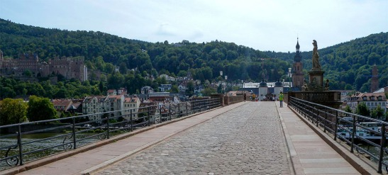 Heidelberg Old Bridge, from the right bank of the Neckar Photograph by David Hill taken 27 August 2015, 11.28 GMT Turner returned to the old bridge and made a second sketch (see CCC 2, above) looking across the bridge, this time from a viewpoint nearer the far bank, beneath the statue of Minerva. As with the first sketch, however, things are not so straightforward as they at first seem. He employs the same device of moving viewpoints halfway through the sketch (the first from the end of the bridge, the second from under the statue so as to bring the castle more tightly into the composition.