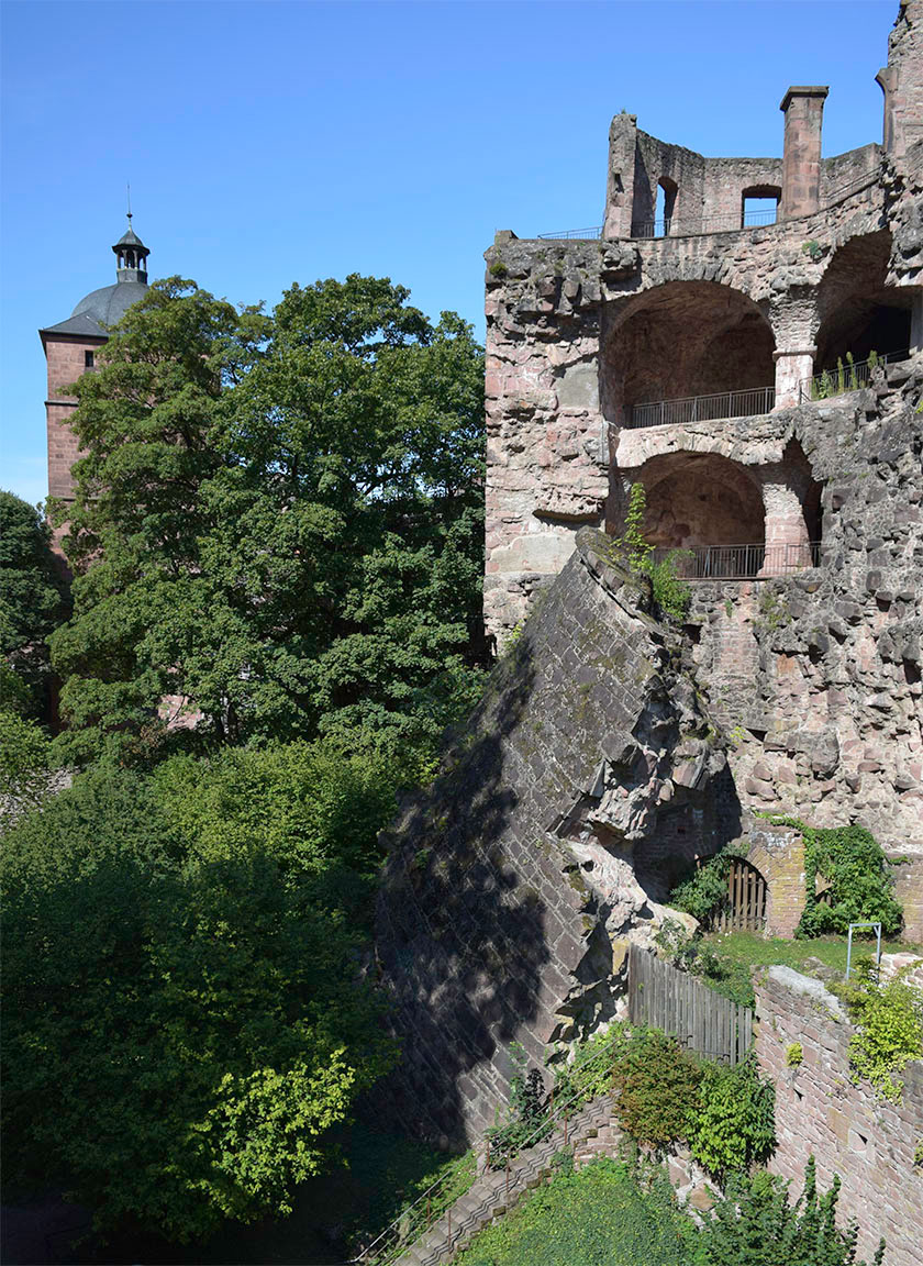 Heidelberg Castle, the Gate Tower and Broken Tower from the South-East angle Photograph by David Hill taken 26 August 2015, 9.21 GMT Returning to the castle entrance, Turner made his way east towards the garden, pausing at the south east angle. When the French attempted to blow up the castle at the end of the seventeenth century, it proved rather more resilient than they might have expected. The attempt to destroy the south east tower succeeded only in toppling part of it into the moat, where it remains, speaking more of resistance than of annihilation.