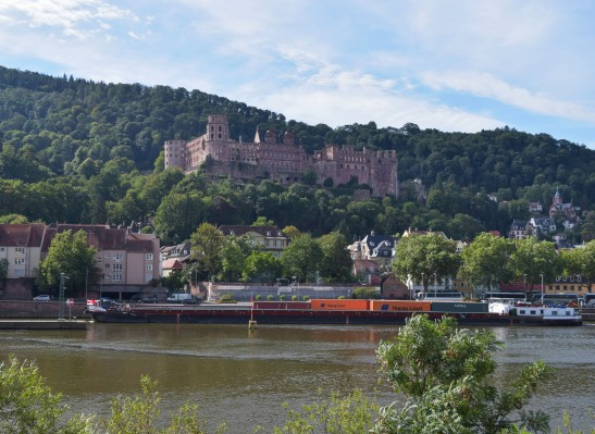 Heidelberg Castle and Palais Weimar from upstream of the old bridge Photograph by David Hill taken 27 August 2015, 08.27 GMT This vantage point, a short walk upstream across the old bridge, is at its best in the morning, when the sun is slanting in from the left. Turner made a long series of sketches at intervals upstream as the spire of the Heiliggeistkirche diminished into the distance.