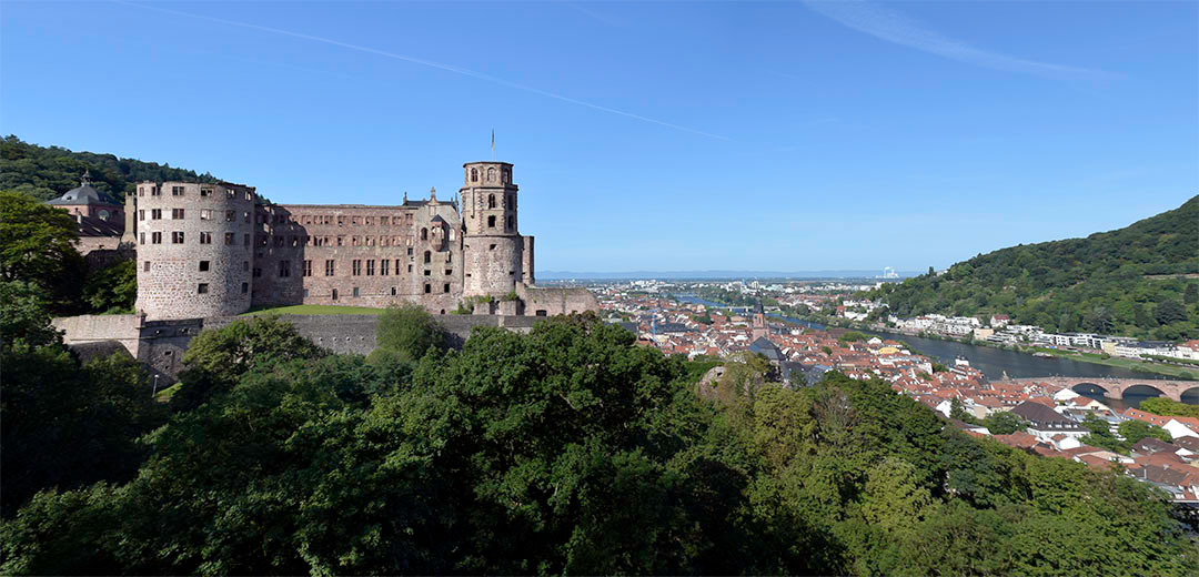 Heidelberg Castle from the Garden Terrace Photograph by David Hill taken 26 August 2015, 7.52 GMT One of the principal viewpoints at Heidelberg is from the magnificent elevated terrace that forms the east side of the gardens of Heidelberg Castle. Turner made numerous sketches there, including his first impression at the beginning of the terrace at its south end (7a) where he appears to have been a little distracted by two rather glamorous ladies that took his eye away from the scenery. As is typical of him, he looked to go further than the regular circuit, so he embarked upon a fairly strenuous (I can testify) clamber around the slopes above the castle to find still more elevated views. His next sketch in the series (8a), is somewhat beyond and above the north end of the terrace. His vantage point must have been quite precarious on the edge of a considerable cliff above the Neckar. He made several further sketches on the slopes, culminating in one (12) at about the height of a path called the 'Elisabethanweg'. The effort of attempting views above the level of the terrace today is wasted; they being all blocked either by new building or unchecked tree growth.