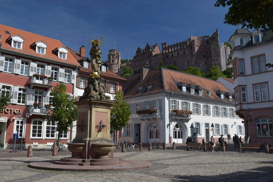 Heidelberg Castle and the Cornmarket from outside the Prinz Carl Hotel Photograph by David Hill taken 26 August 2015, 13.01 GMT Occasionally there is a record of exactly where Turner stayed on his travels. In 1995 Cecilia Powell (Turner and Germany, p.74) discovered documentation that Turner stayed in the Prinz Carl Hotel on the Cornmarket at Heidelberg. A newspaper reported him there 24-27 August 1844. Powell also identified a sketch from a tour dated to 1840 of the view from his room. The building that Turner stayed in was demolished in the 1970s but was replaced by a building of similar footprint and general elevation. Lining up the angles from the opposite side of the square it is possible to pinpoint the exact position of Turner's room.
