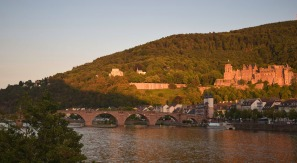 Heidelberg at sunset Photograph taken by David Hill 25 August 2015, 17.56 GMT Showing exactly the same shadow as in the Manchester watercolour, being cast by the sun dipping behind the Michaelsberg behind us.