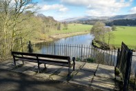 "Church Brow, Kirkby Lonsdale: Site of Benches Photograph by David Hill, taken 25 March 2016, 11.09 GMT ""..Just at the dividing of the two paths, the improving mob of Kirkby had got two seats put for themselves—to admire the prospect from, forsooth...."" Ruskin's original benches have been removed and replaced."